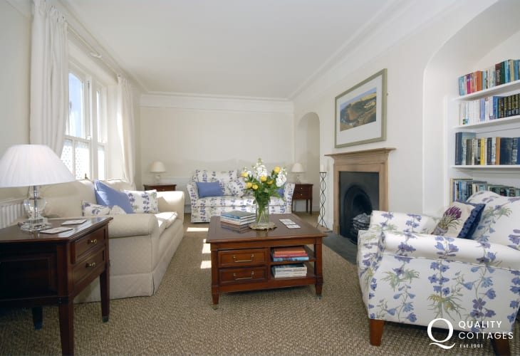 Manorbier coastal holiday cottage - elegant sitting room with piano and feature fireplace