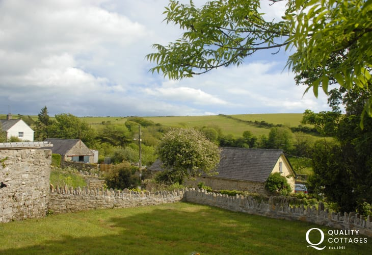 The garden at Ty Mor Cottage overlooks lush surrounding countryside