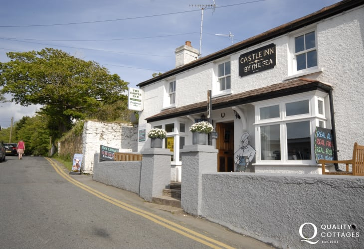 The Castle Inn is a cosy village pub serving good bar snacks and traditional ales