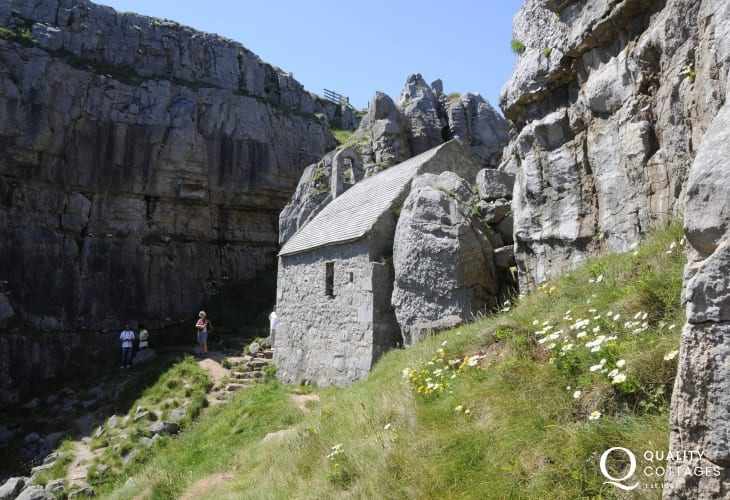 St Govans Chapel, home to the 6th century hermit, nestles in the rocks on the coast path