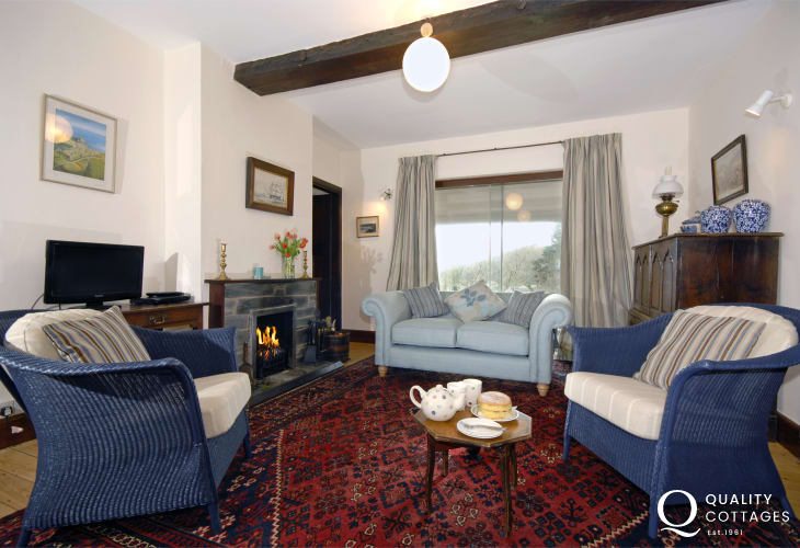 Saundersfoot coastal holiday home - sitting room with sea views and open fire