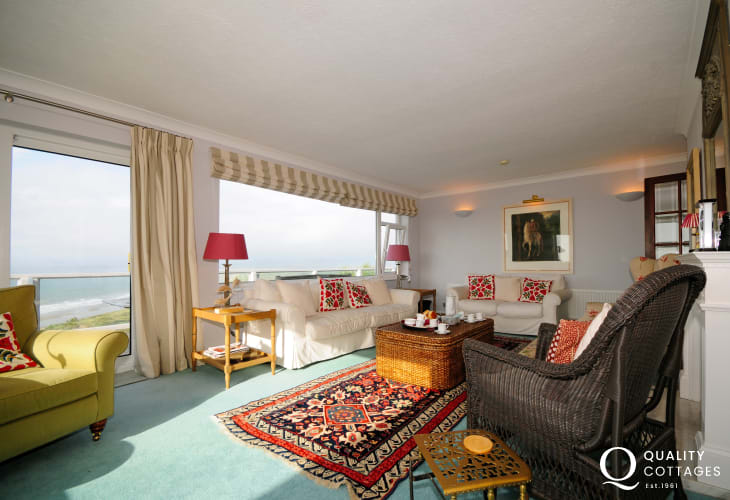Holiday cottage in Harlech, South Snowdonia. Lounge with panoramic views over Llyn Peninsula and patio doors onto balcony.