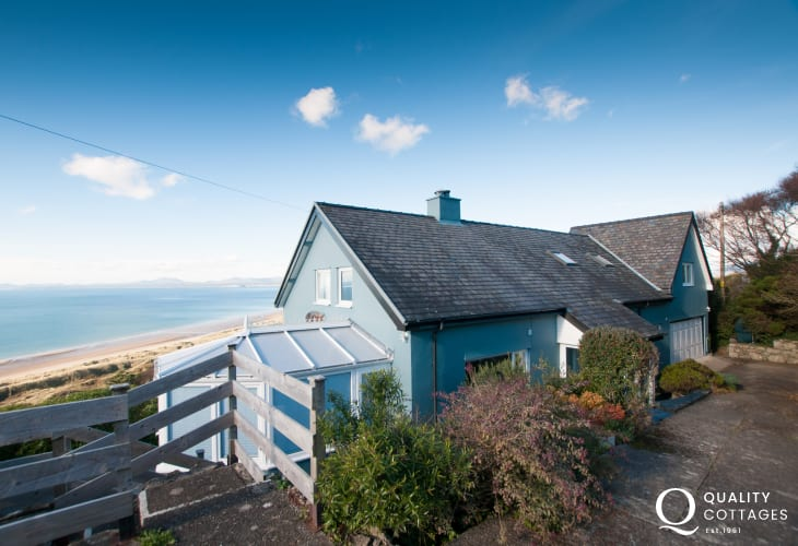 Beachfront dog friendly holiday cottage in Harlech, South Snowdonia - sea views from the exterior of the property.