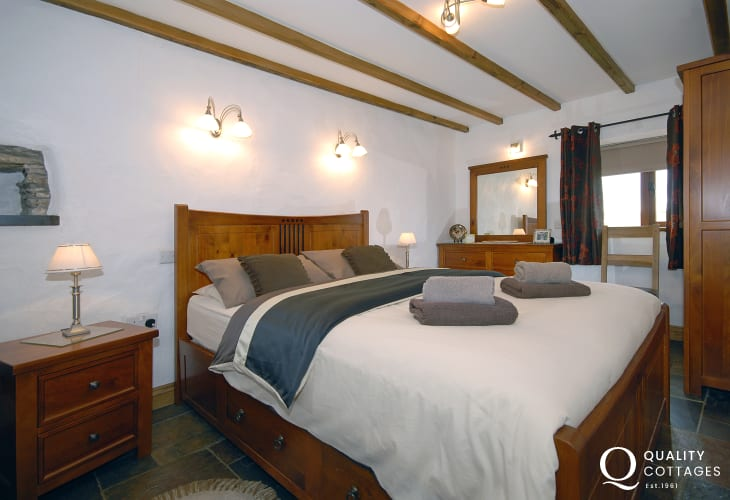North Pembrokeshire holiday cottage - ground floor double bedroom with king-size bed and 'Jack and Jill' door to wet room