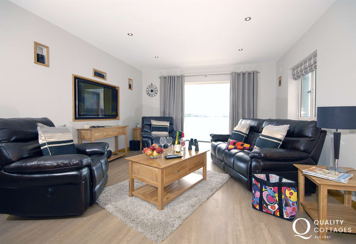 Haven Waterway holiday apartment - open plan lounge with bi-folding doors to deck and river views