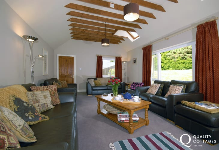 St Davids family holiday home - living room with French doors to the garden