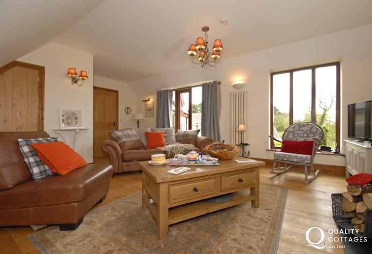 Stackpole Pembrokeshire modern holiday cottage - first floor sitting room with woodland views