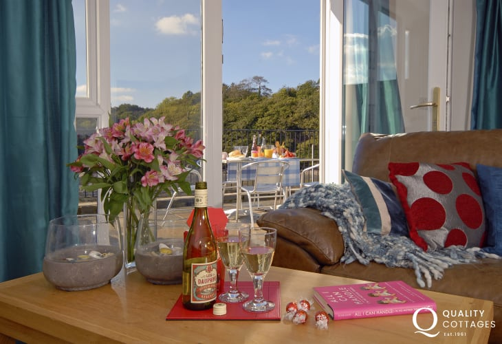 Waterside Pembrokeshire holiday home - sitting room with doors to terrace