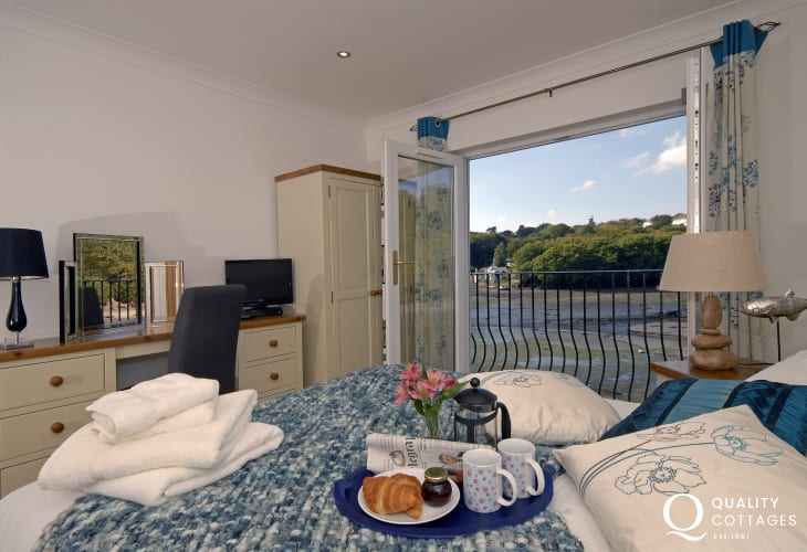 South Pembrokeshire holiday home - master bedroom with t.v and river views