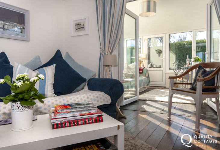 Broad Haven South holiday cottage - warm and cosy living room and sunny garden room