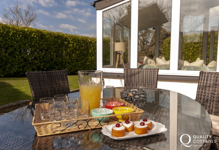 Relax in Rattan garden furniture at Ty Ceirios Bosherston holiday cottage