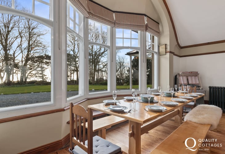 Dining table by bay windows in family room