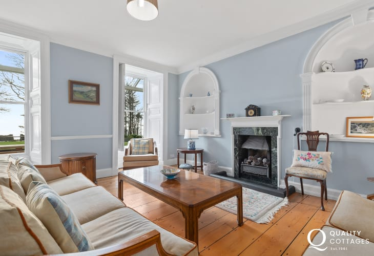 Elegant Sitting Room with open fireplace, original floor boards and large sash windows