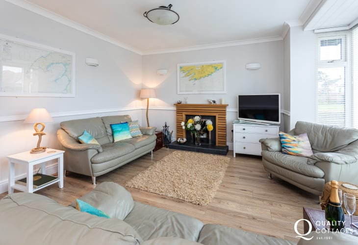 Large lounge with comfy sofa and armchair in self-catering cottage, Rhosneigr, Anglesey
