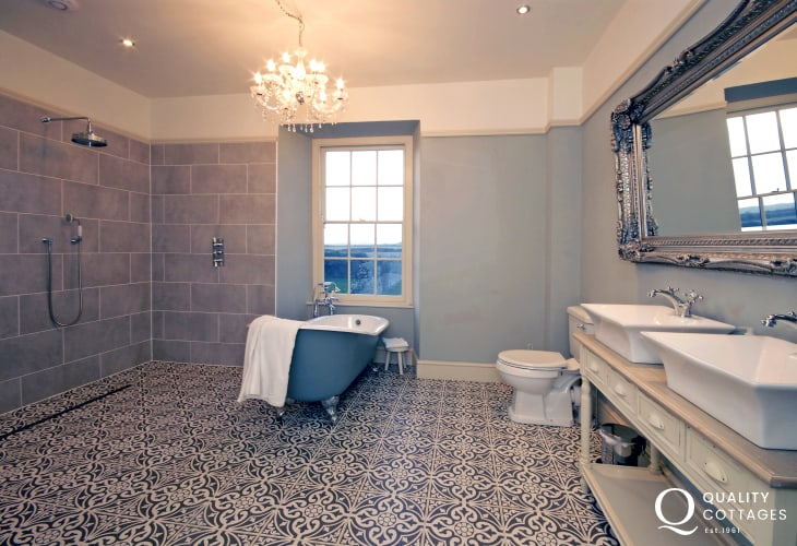 St Davids holiday farmhouse - luxury family bathroom with double washbasins and double wet room shower