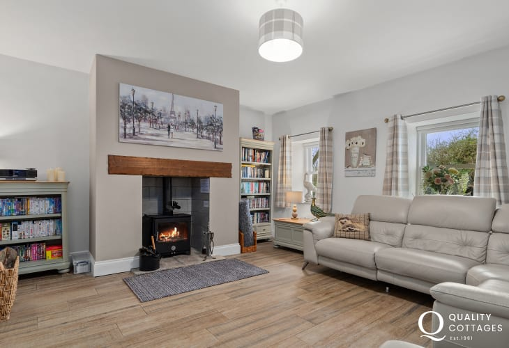 Sitting room, leather L-shaped sofa and wood burning stove