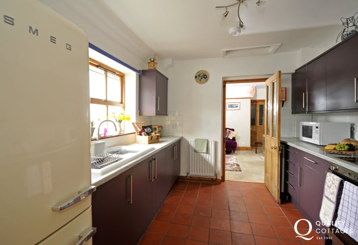 Bright spacious kitchen with Smeg fridge at Smolts Brook