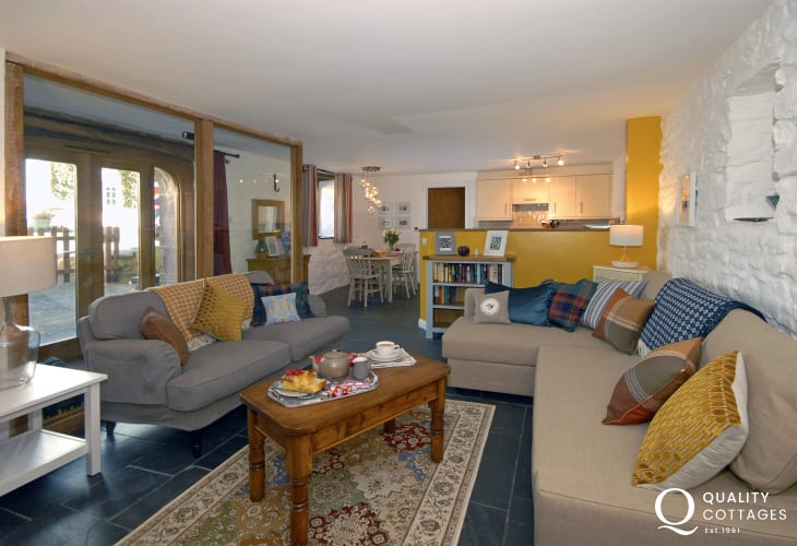 St Davids, Pembrokeshire luxury ground floor apartment - open plan living room with wood burning stove