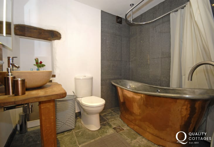 St Davids holiday apartment - Luxury en suite bathroom with shower over copper bath