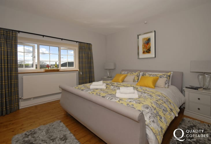 Luxury Carmarthenshire holiday home - super kingsize master bedroom with estuary views