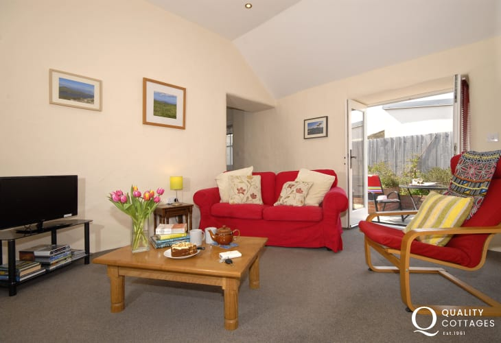 St Davids, Pembrokeshire - holiday cottage sitting room with French doors to the patio