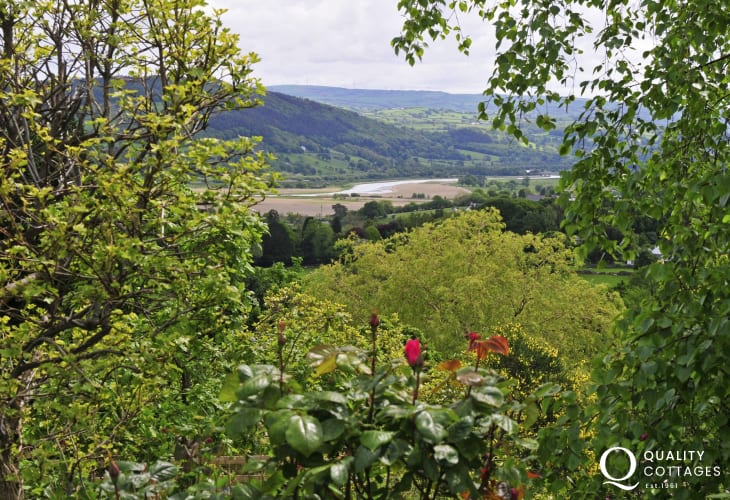 View of the lush green Conwy Valley from the cottage grounds