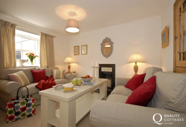 St Davids, Pembrokeshire holiday cottage - cosy sitting room with feature fireplace
