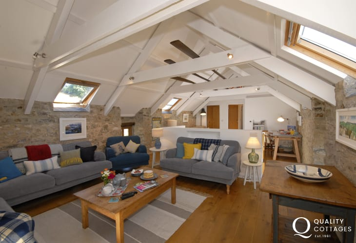 St Davids, Pembrokeshire 18th century holiday home - open plan living room with vaulted beamed ceilings