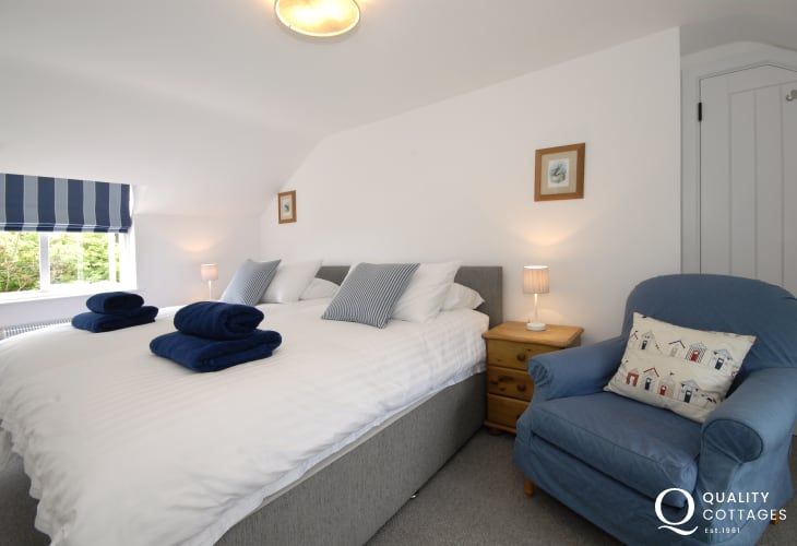 Pets welcome to Cwm yr Eglwys holiday cottage - double bedroom bedside cupboards with bedside lamps