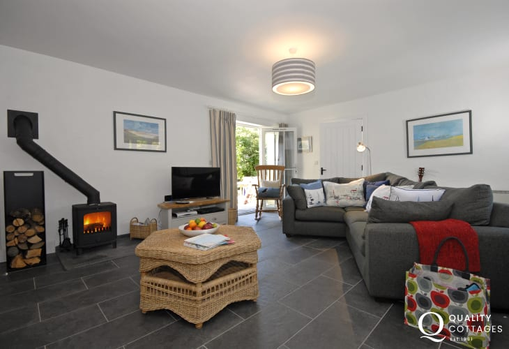 Cwm yr Eglwys seaside cottage holiday - lounge with log burner