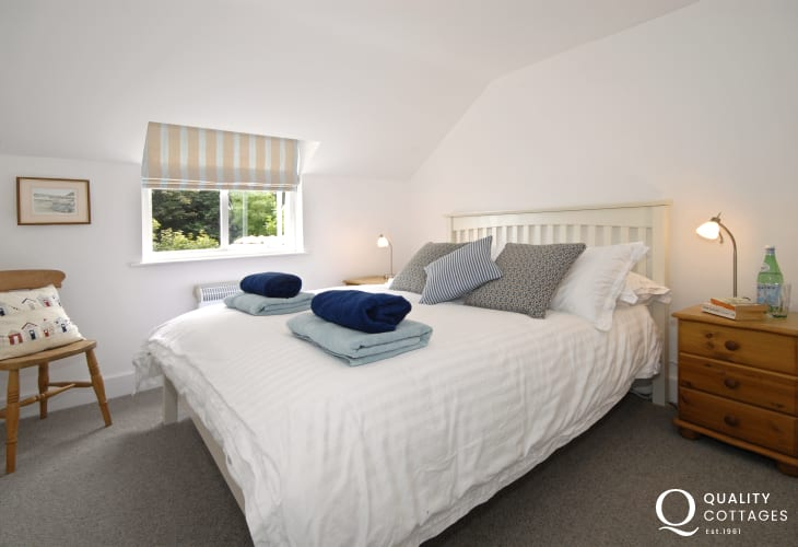 Seaside cottage holiday - master bedroom double bed bedside lamps and cupboards