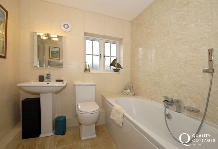 Solva holiday cottage - family bathroom with separate walk-in shower