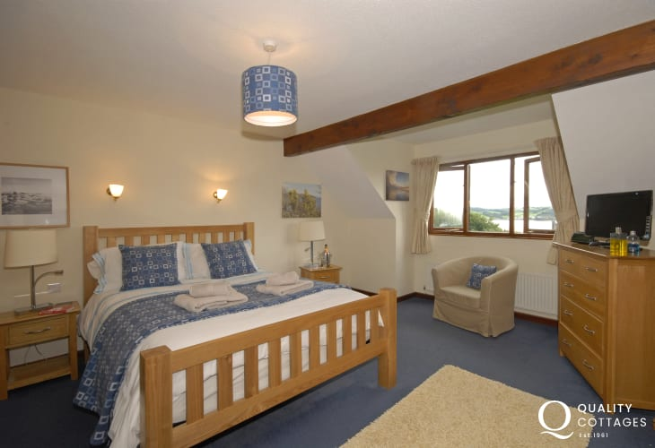 Carmarthenshire holiday home - kingsize master bedroom with t.v. and estuary views