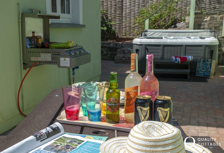 Solva family holiday home with sheltered patio with picnic bench BBQ and hot tub