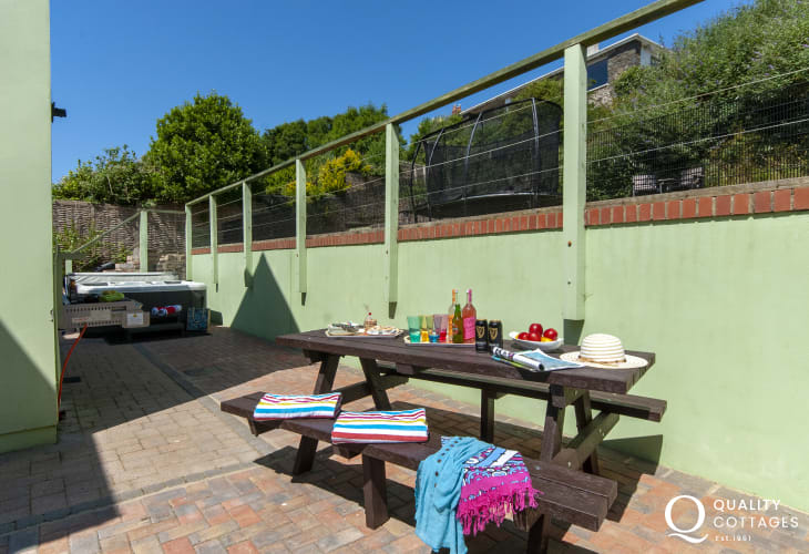Dog friendly holiday home Solva - patio with picnic bench and hot tub