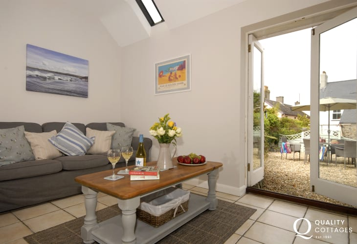 St Davids cottage - open plan living space with French doors to garden