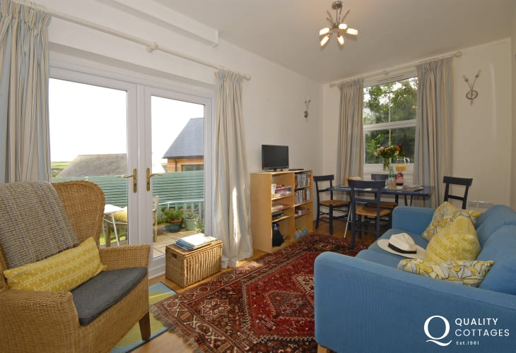 Solva holiday cottage - garden room with patio doors to the terrace