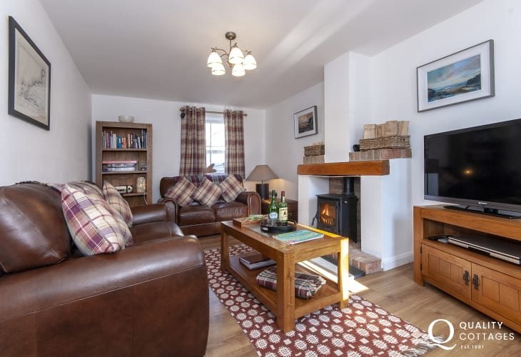 St Davids holiday cottage - cosy living room with wifi and log burning stove