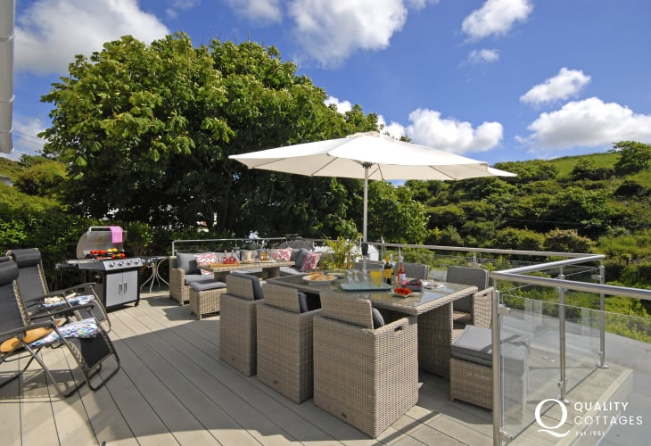 Little Haven luxury holiday home  - deck with rattan seating for 10 guests