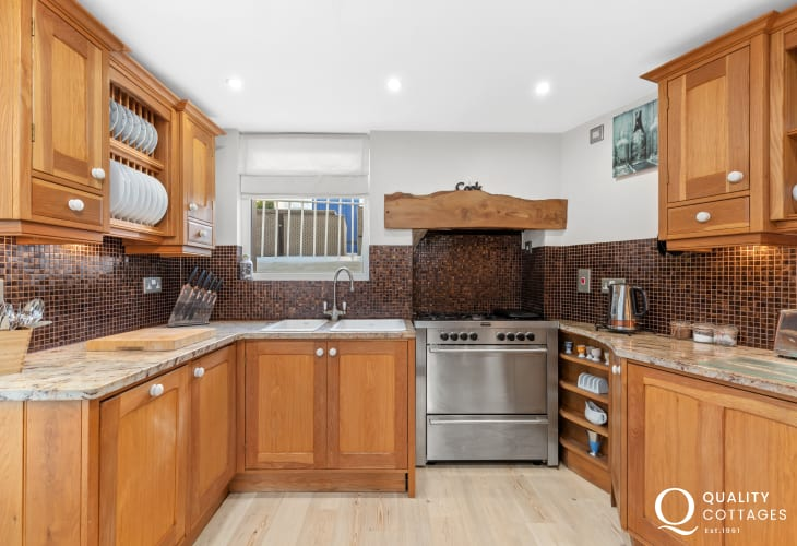 Shaker style kitchen with mosaic splashback and range cooker