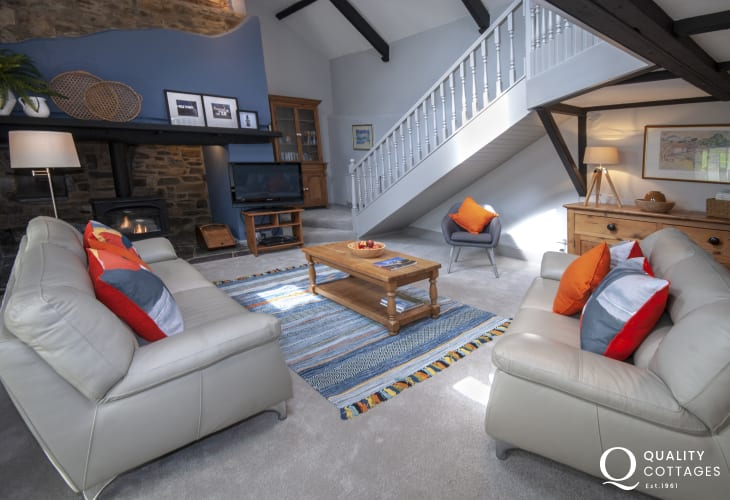Pet friendly Aeron Valley holiday cottage - open plan living room with stairs to the gallery
