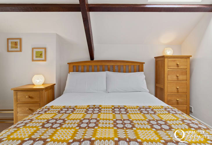 Beamed double bedroom with oak furniture