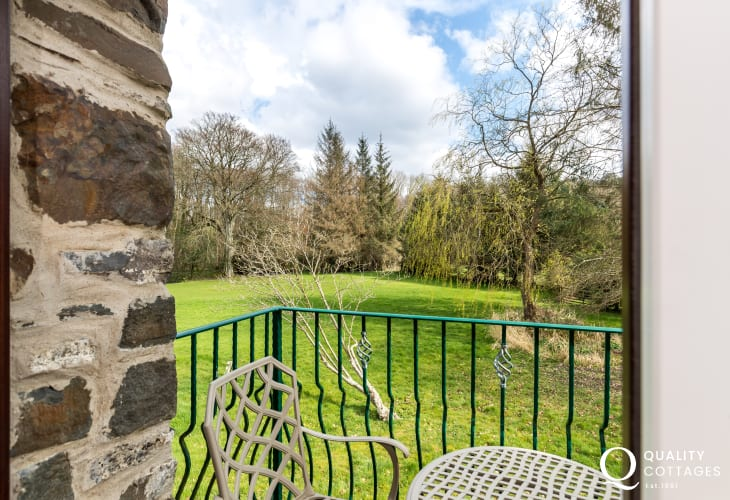 Private balcony with views out over stunning grounds and woodland