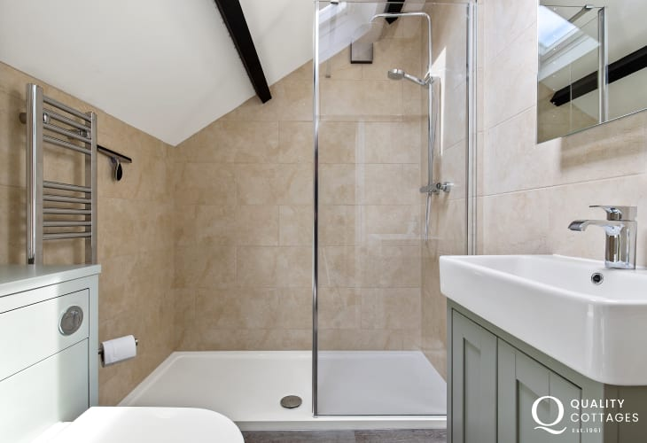 Bathroom with walk in shower, heated towel rail, basin and toilet