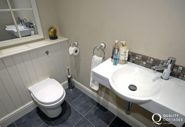Cloakroom with toilet and washbasin on ground floor