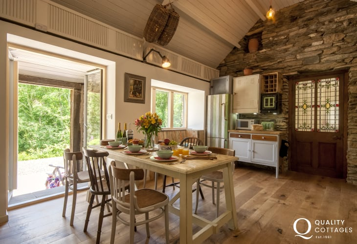 Open plan kitchen/dining area with garden views