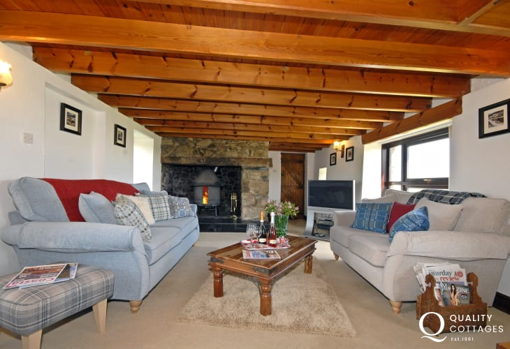 North Pembrokeshire stone cottage - cosy living room with Jotul wood burner