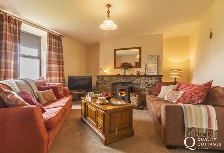 St Davids traditional Welsh farmhouse for holidays by the coast - living room with wood burner