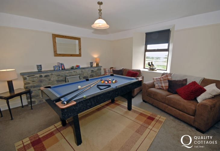 St Davids holiday farmhouse - sitting room with pool table