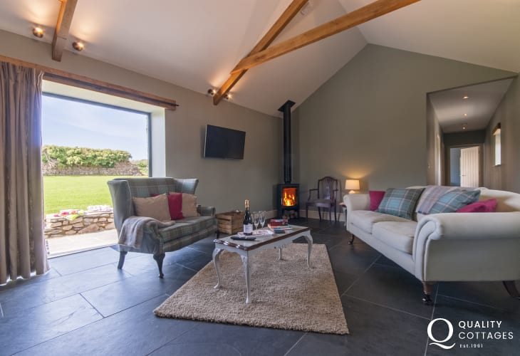 St Davids holiday cottage - living area with log burner